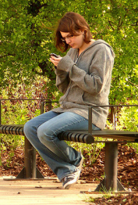 Texting in the Park by Tom Bream