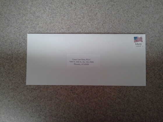 Self-Addressed Unsealed Stamped Envelope Ready for the Mail