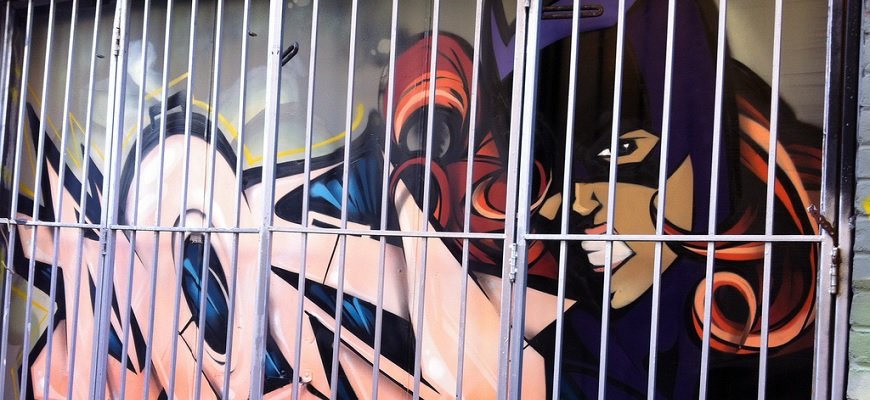 Batgirl on Jersey Ave. (behind bars) by margonaut from Flickr (Creative Commons License)